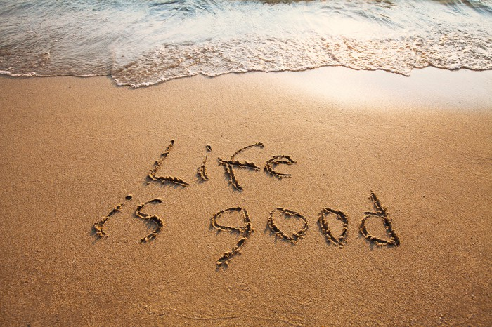 """Life is good"" written in the sand"