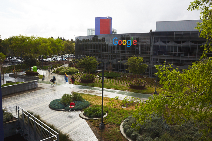 A Google campus with the logo on the building.