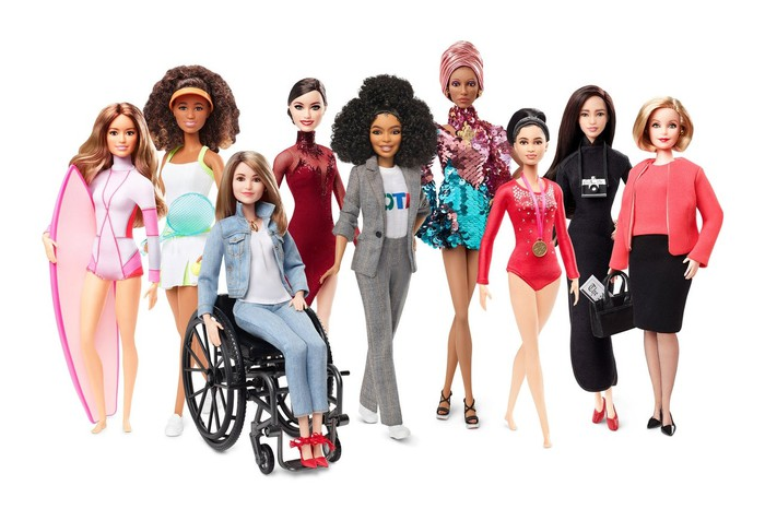 A lineup of Barbie dolls.