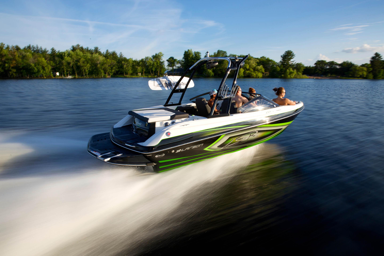 People on speedboat on lake