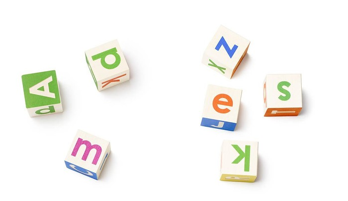 Seven alphabet blocks showing different-colored letters.