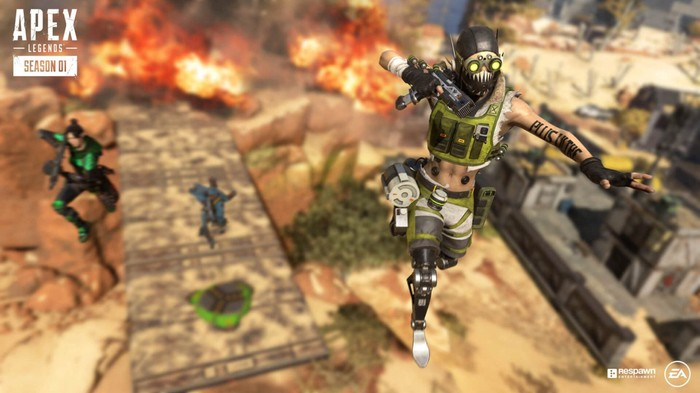 An in-game image from EA's Apex Legends video game showing two characters jumping high into the air with a fire burning in the background.