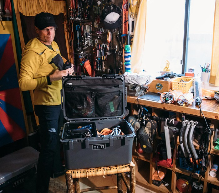 Man packing a Yeti GoBox with gear