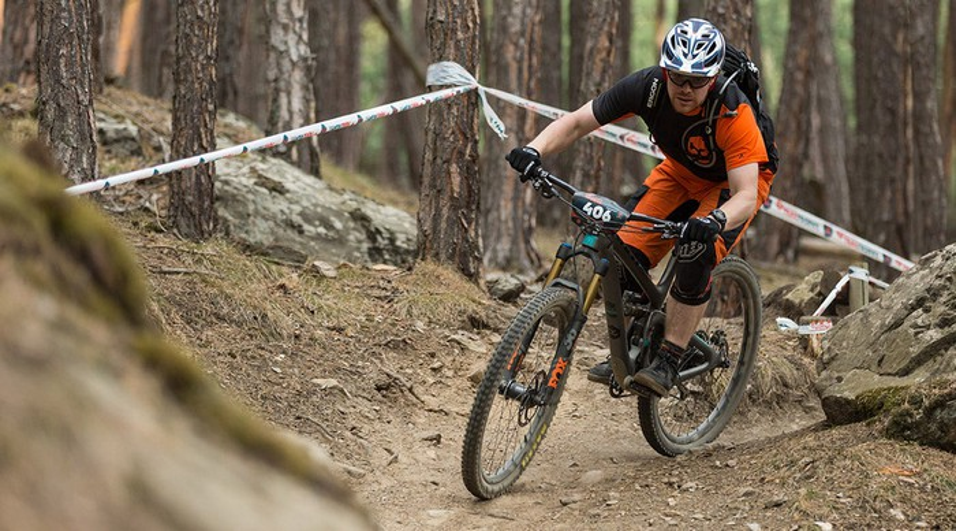 A Fox Factory rider on a mountain bike