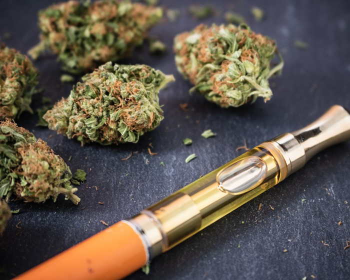 Buds of marijuana and a vaporizer pen.