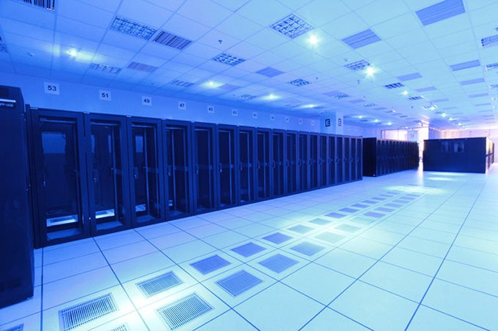 Interior of a data center showing servers around perimeter of room.