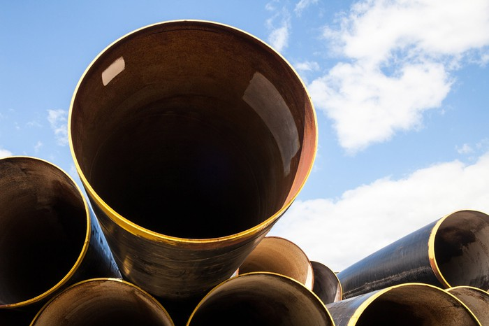 A stack of pipelines with a blue sky in the background.