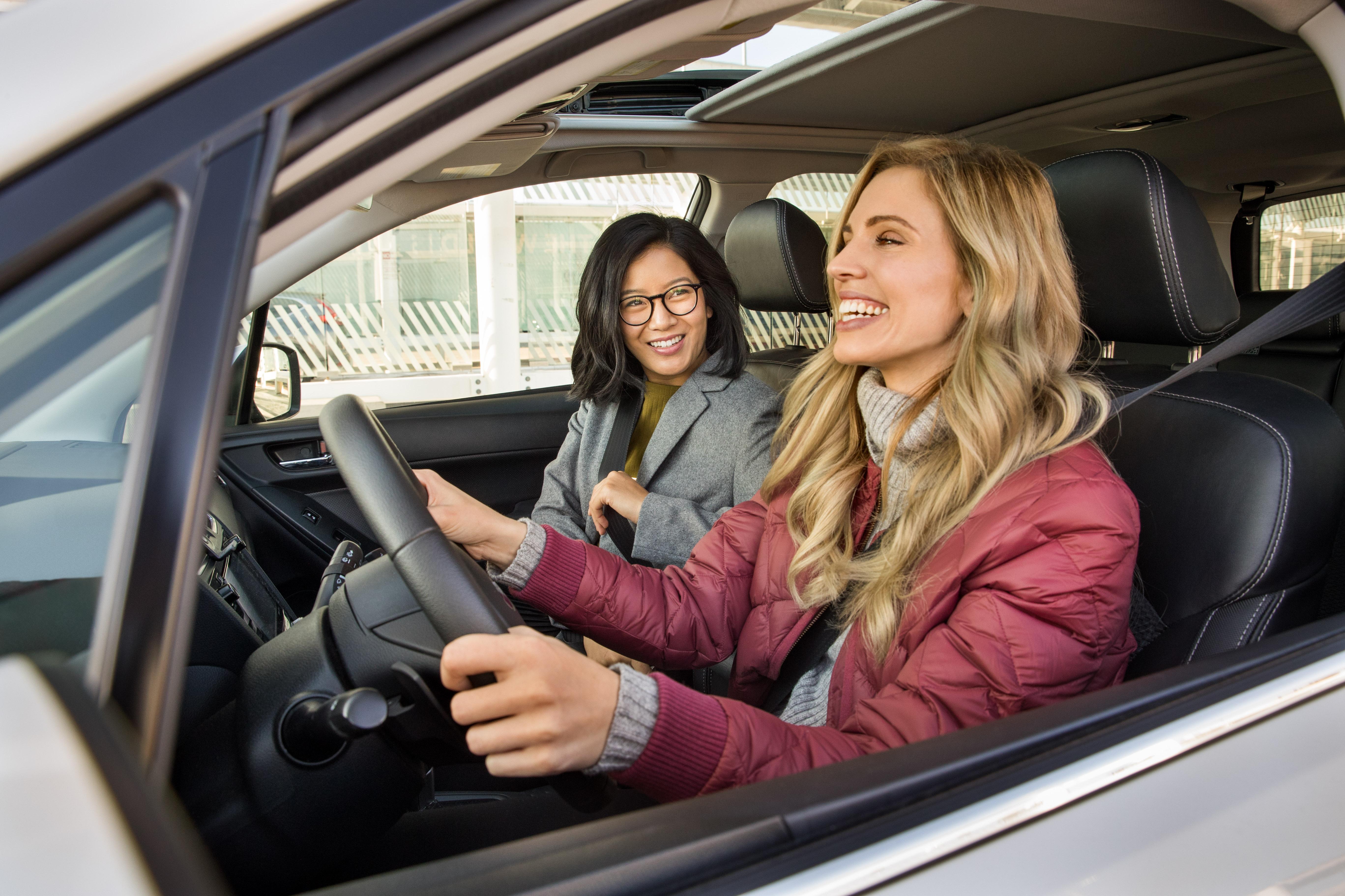 A Lyft driver and a passenger inside a car