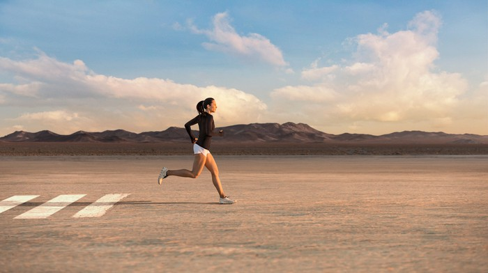 A woman running in the desert while wearing Lululemon clothing.