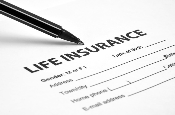 Pen resting on life insurance application