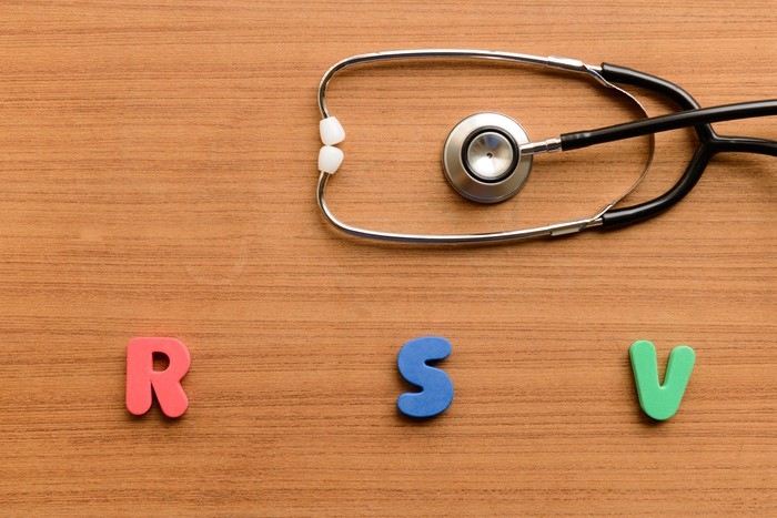 RSV spelled out using colorful wood blocks set against a wooden background.
