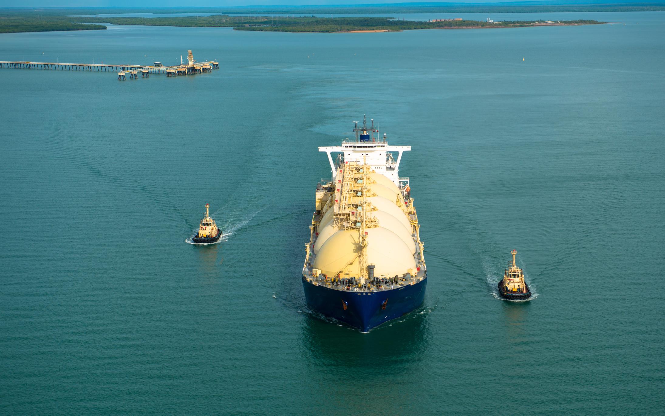 An LNG tanker leaving a port terminal.