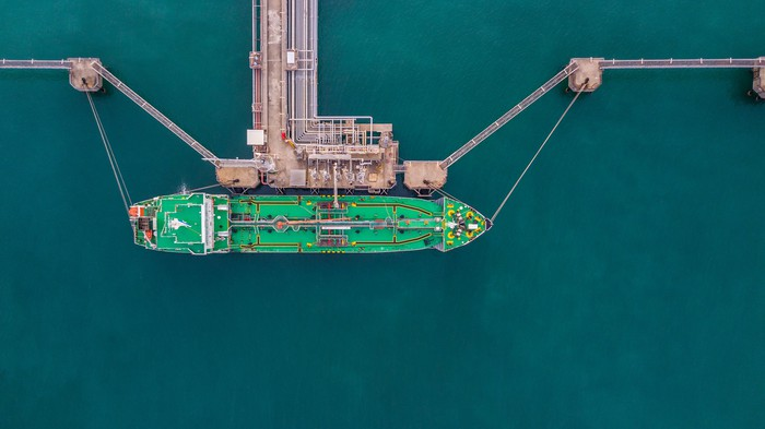 A liquefied natural gas vessel being loaded