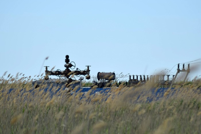 An oil and gas well in a field.