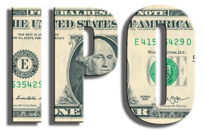 """The letters """"IPO"""" cut out of a dollar bill."""