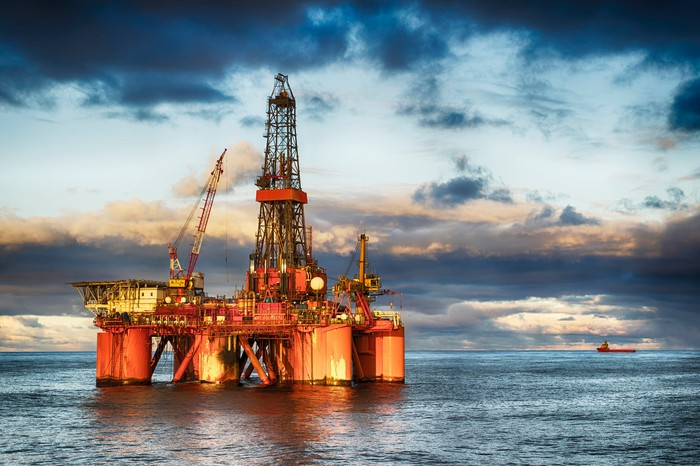 An offshore drilling rig at dusk.