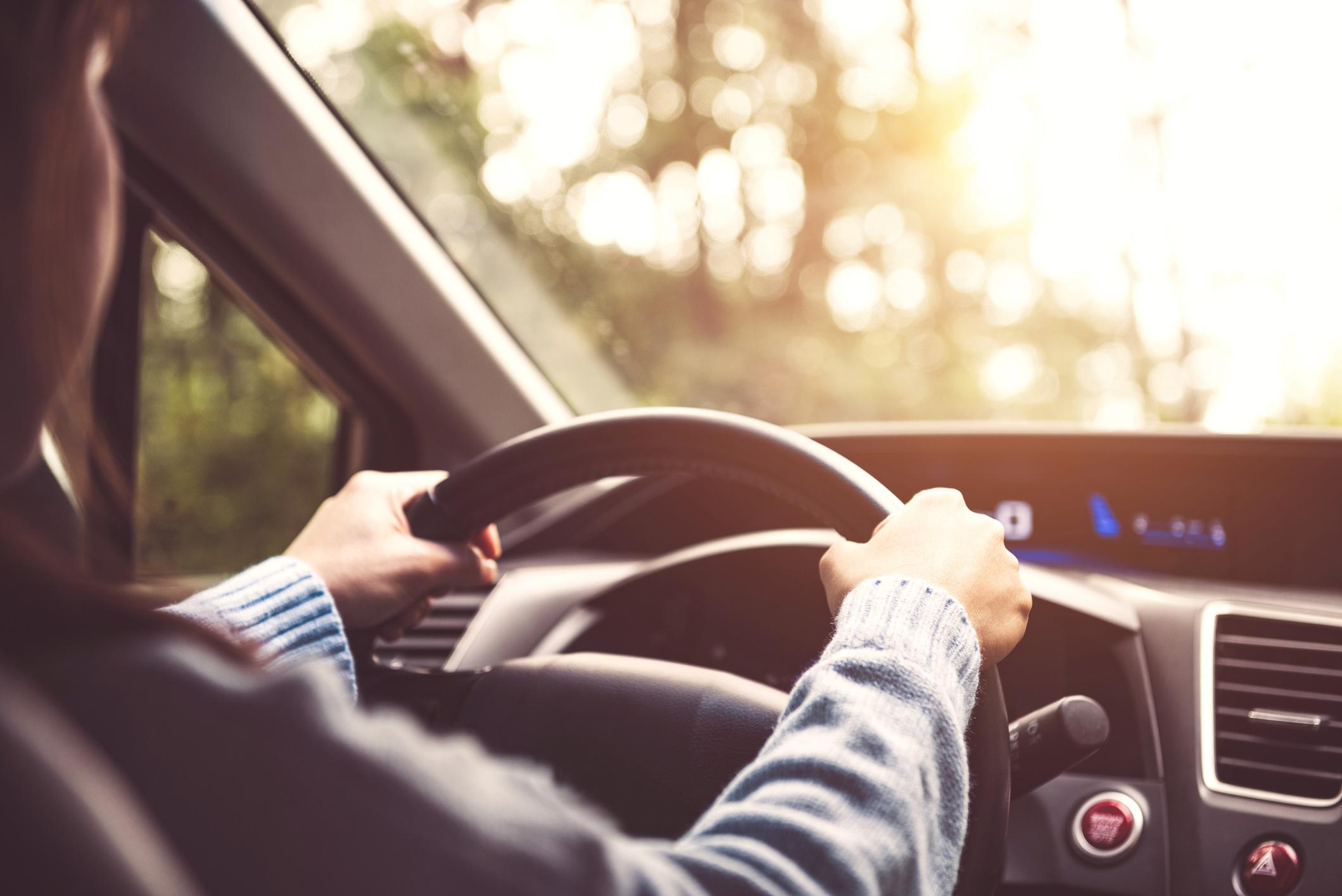 Person driving a car.