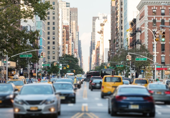 A New York City street with cars.