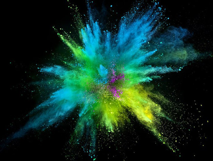 A explosion of blue, yellow, and green colors on a black background.