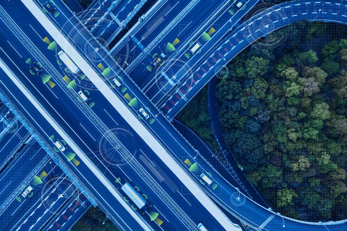 An overhead view of autonomous vehicles on a highway.