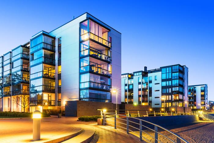 Modern real estate buildings lit up.