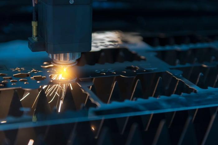 A laser cuts through metal.