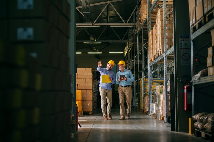 Two men in a warehouse
