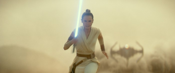 A woman holding a light saber running as a small spacecraft gains on her.