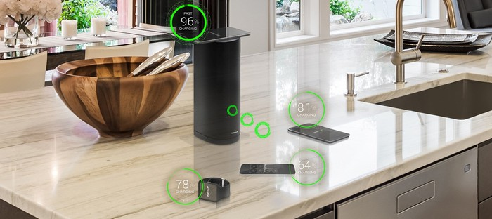 Devices being wirelessly charged in a kitchen.