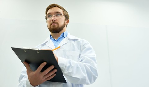 guy-in-a-lab-coat-with-a-clipboard-getty