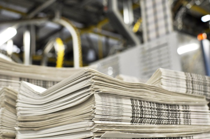 A freshly-printed stack of newspapers in a printing plant.