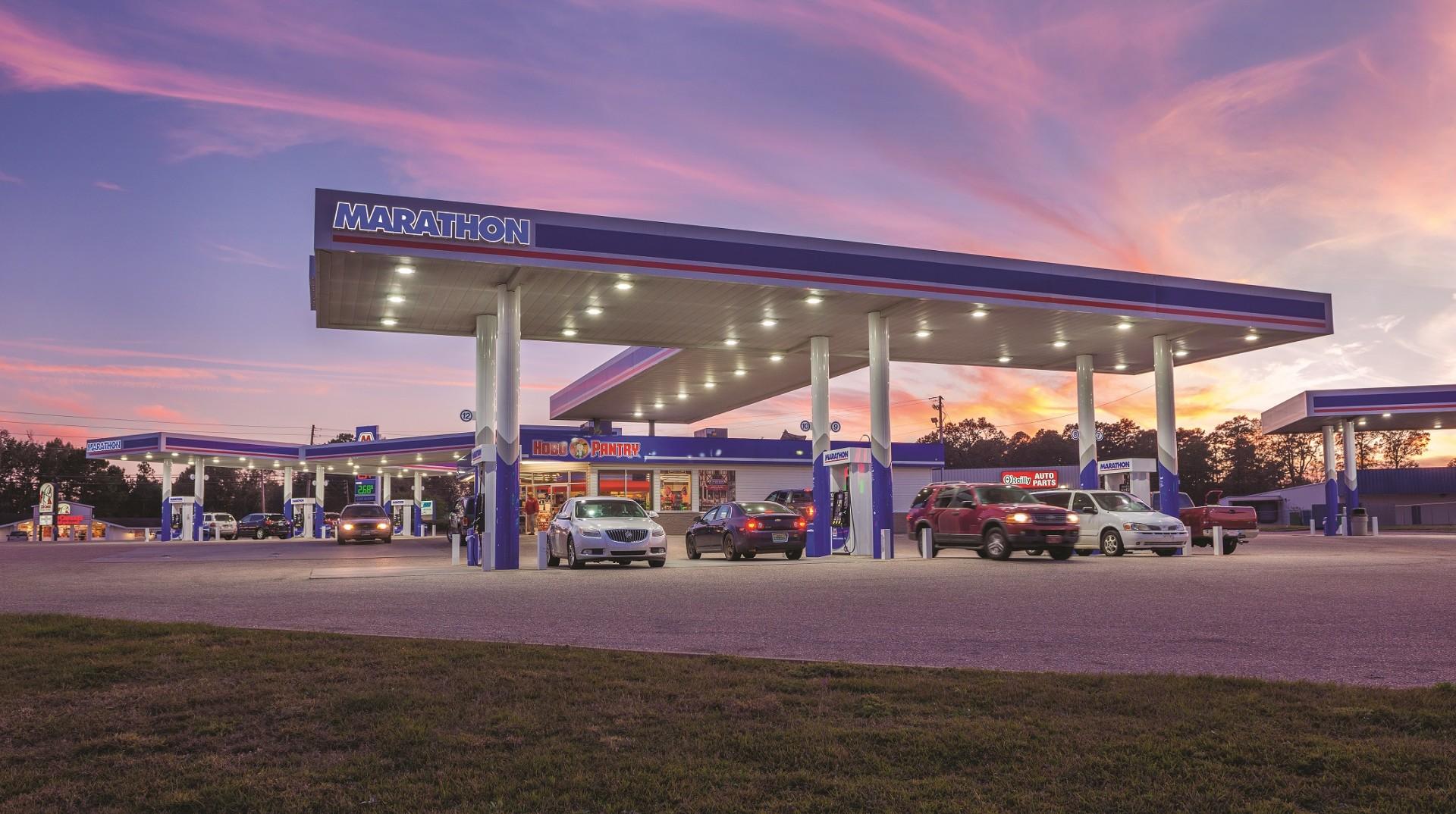 Gas station with Marathon awning near sunset.