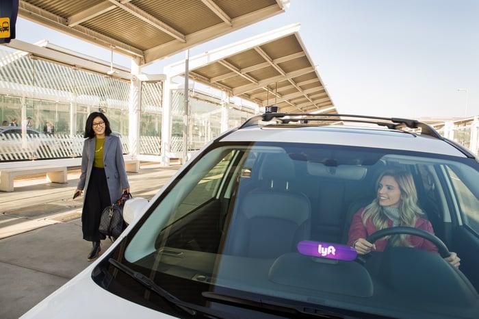 A Lyft driver picking up a fare