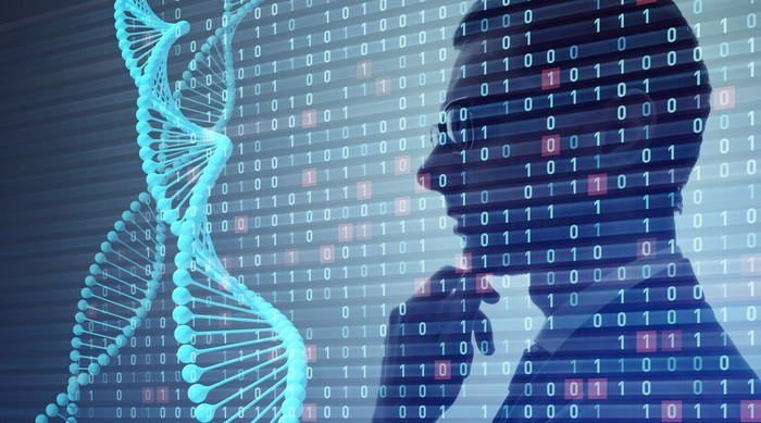 A person thinking as he looks at a double-helix DNA.