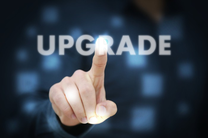 A person pointing to the word upgrade