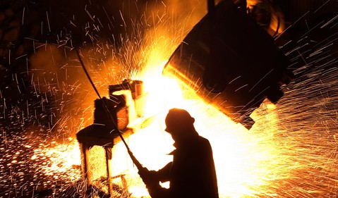 18_11_26 a man standing in front of hot sparking steel_GettyImages-177541735
