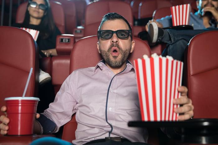 Movie watcher with soda and popcorn