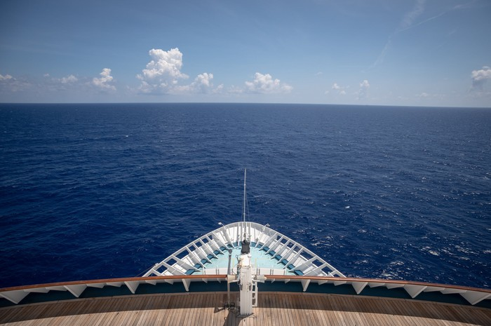 A close-up of a cruise ship's bow on the open sea.
