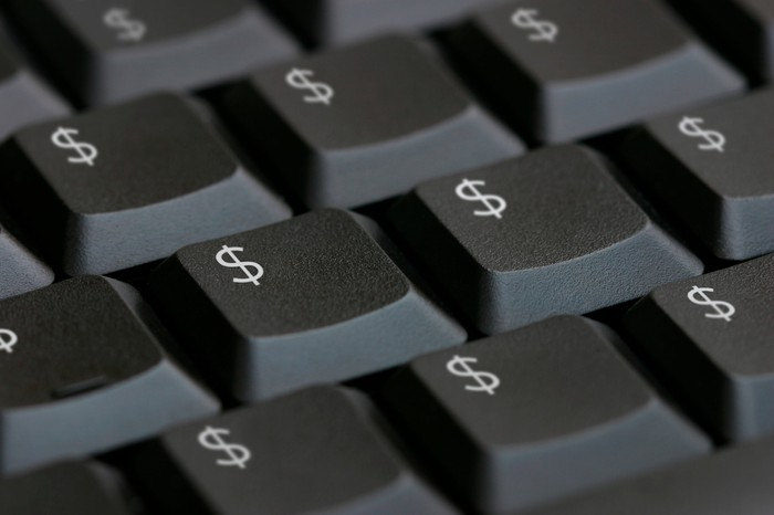 Close-up of a computer keyboard on which every key is labeled with a dollar sign