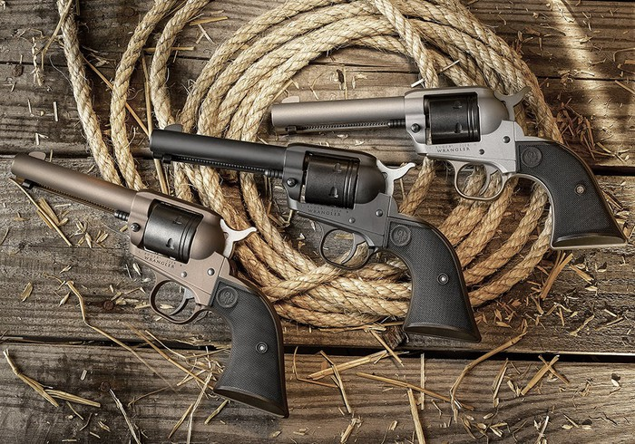 Three revolvers lying on a coil of rope