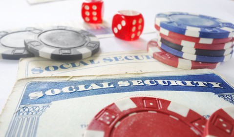 Social Security Card Dice Gamble Chips Benefit Cut CPI Entitlement Getty
