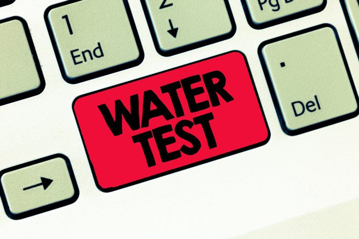 """A red """"water test"""" key on a keyboard."""