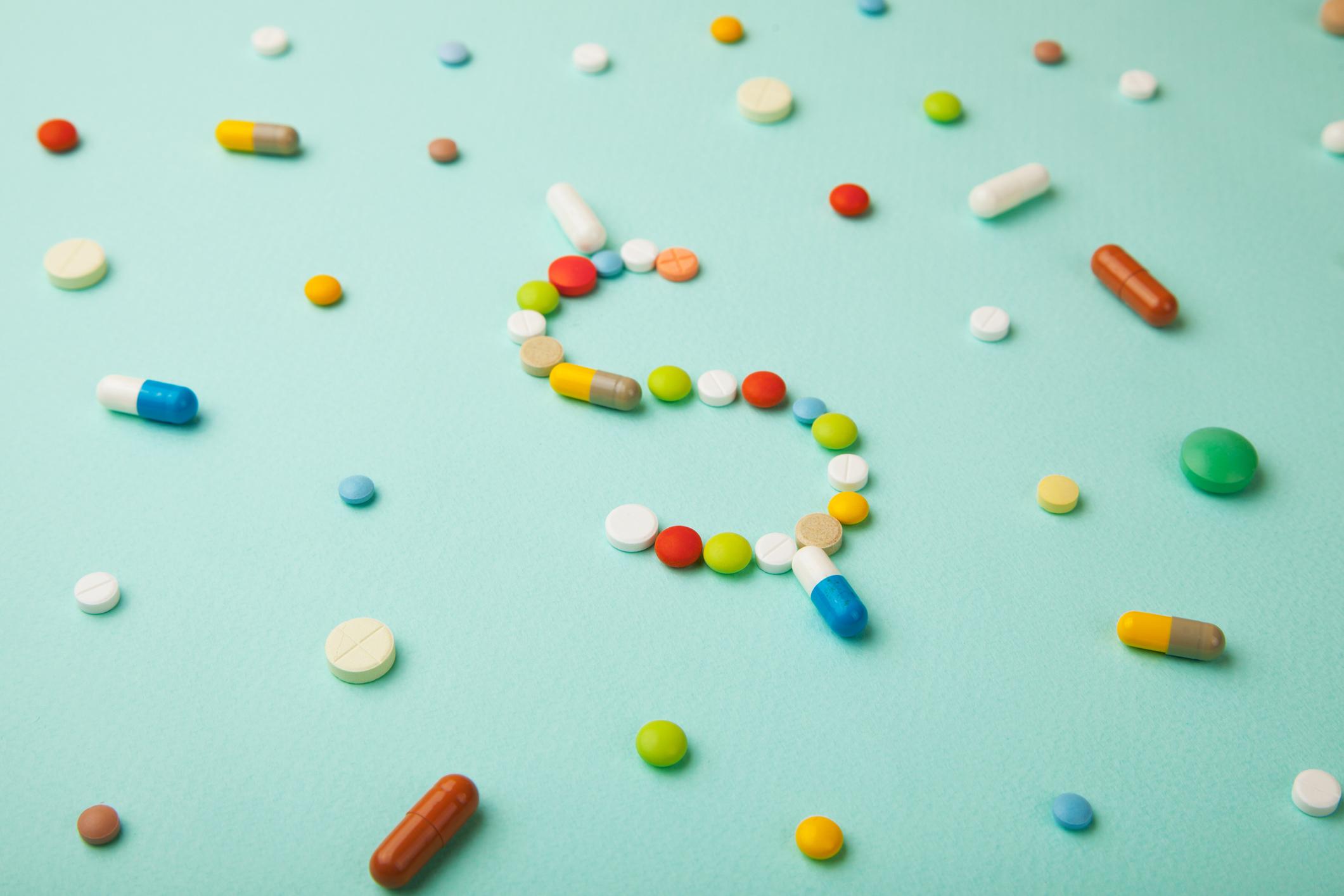Dollar sign formed in pills