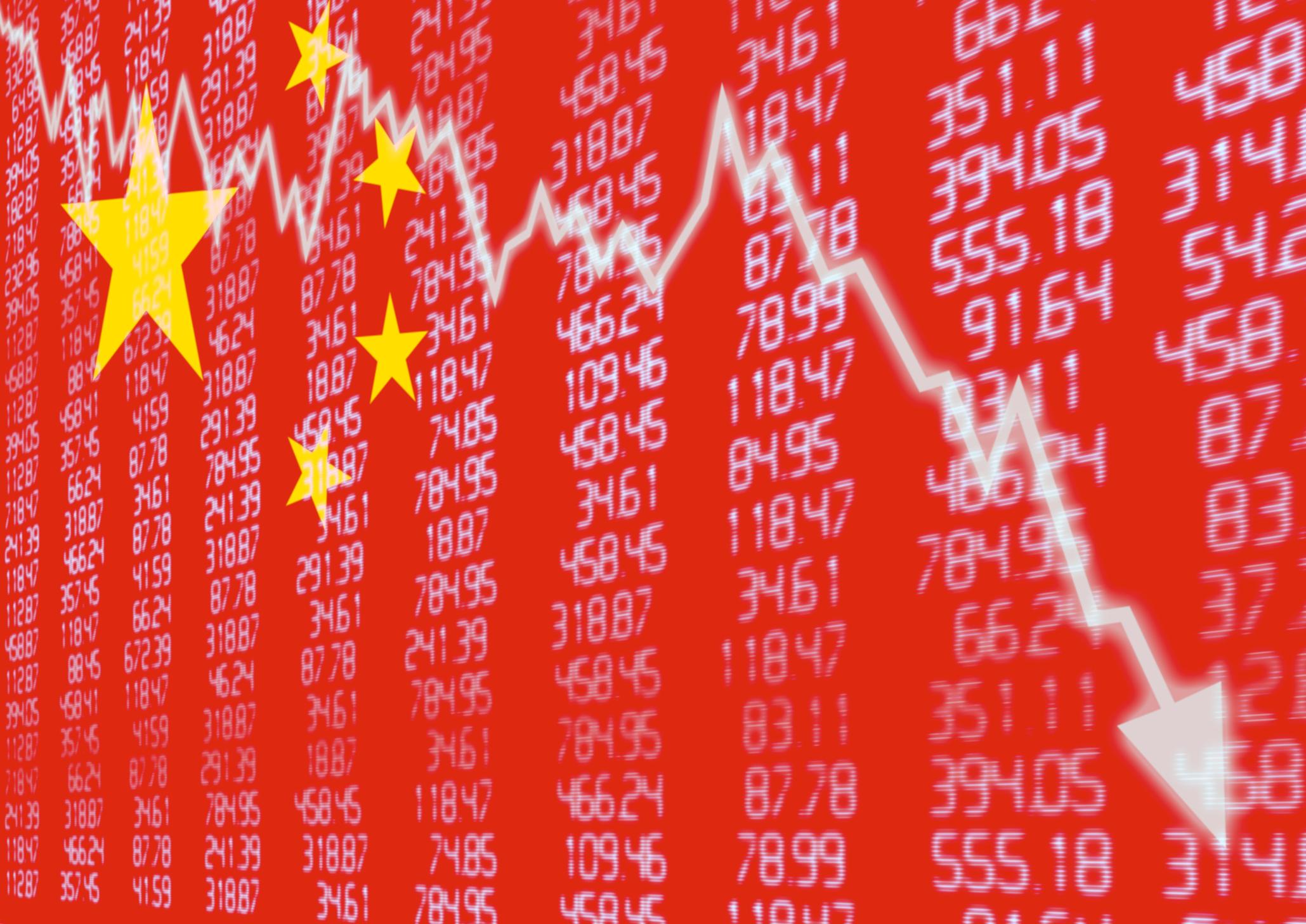 Chinese flag superimposed on falling stock market chart.