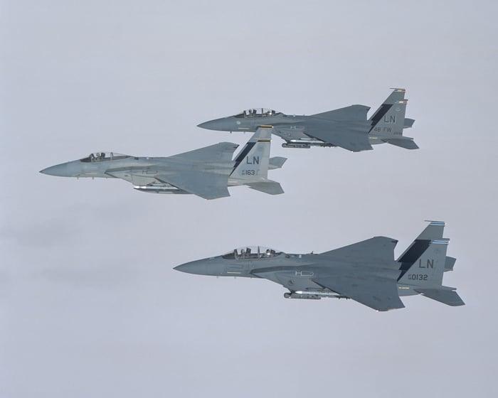 Three Boeing F-15s in flight.
