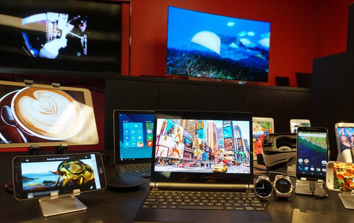 Various devices with OLED displays: laptops, tablets, TVs, smartphones, and smart watches.