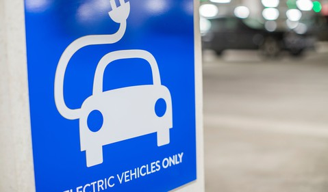 19_04_22 a sign that read electric vehicles only with a car and an electric cord on it_GettyImages-918985152