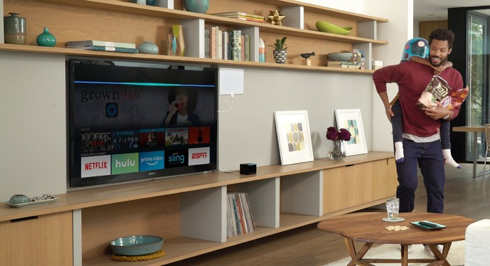 Fire TV Cube next to a TV in a living room