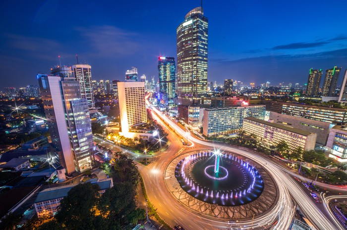 Photo of Indonesian capital Jakarta at night, highlighting bright lights and bustling traffic.