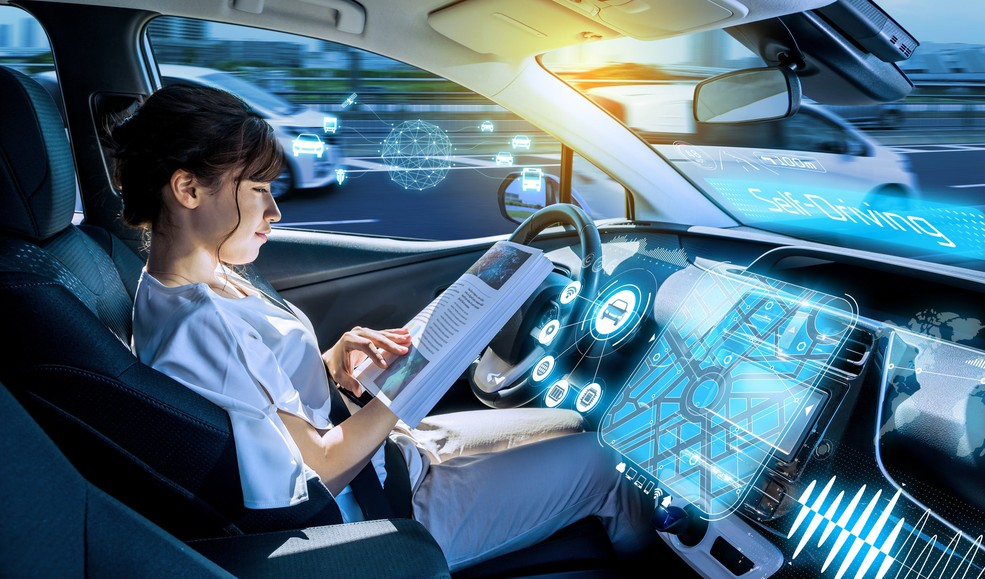 Image 6 A woman sits in a driverless car